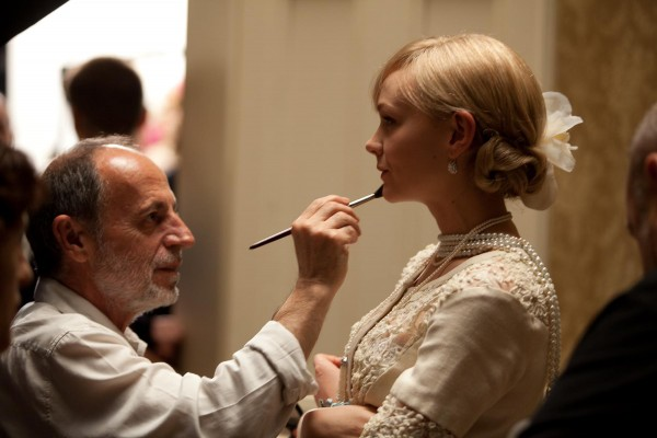 """(L-r) Make-up designer MAURIZIO SILVI and CAREY MULLIGAN behind the scenes of Warner Bros. Pictures' and Village Roadshow Pictures' drama """"THE GREAT GATSBY,"""" a Warner Bros. Pictures release. Photo by Matt Hart"""