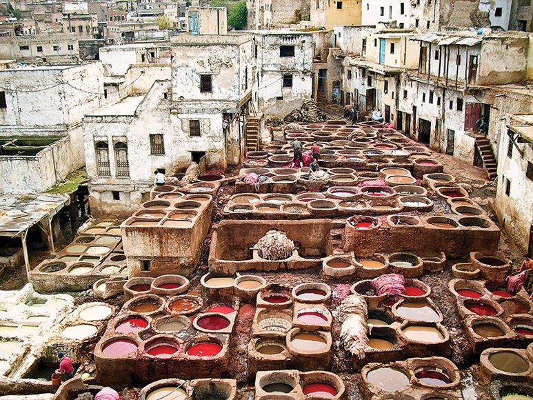 Vats of dye at an open-air leather tannery in Fes, Morocco. Courtesy of Getty Images