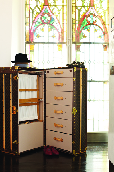 A Louis Vuitton steamer trunk provides added storage in the bedroom