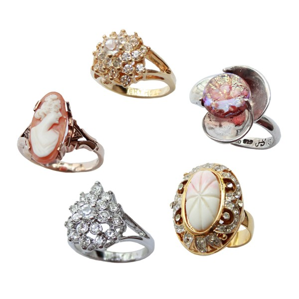 Assorted mid-century rings, including a 10k gold Birks cameo ring; image courtesy of Magwood