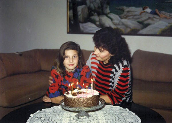 10-year-old Sandra with her mother, who is wearing one of her own sweaters