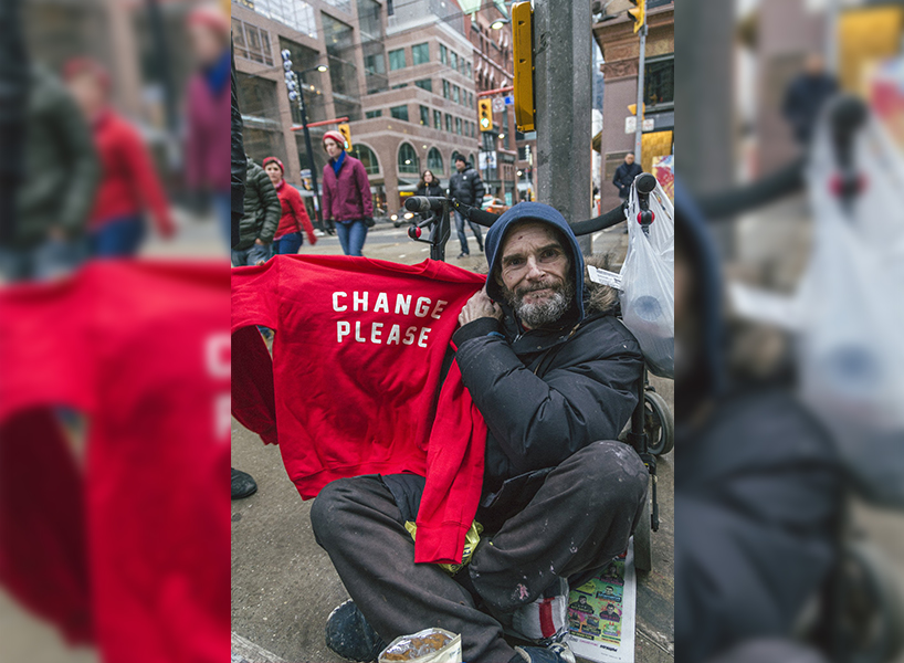 Homeless Toronto gives away free sweatshirts from their collection to people living on Toronto's streets