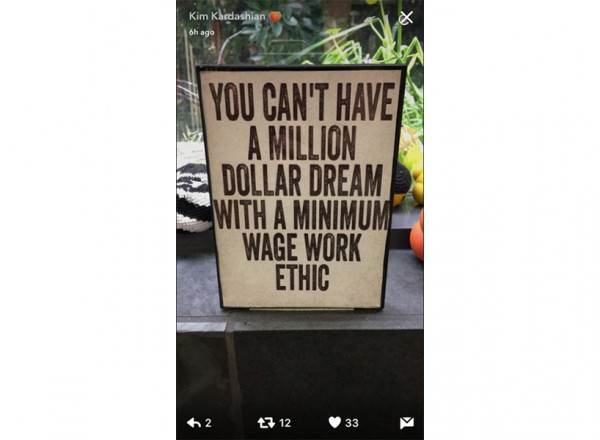 "Kim Kardashian Snapchatted a sign that read ""You Can't Have A Million Dollar Dream With A Minimum Wage Work Ethic"""