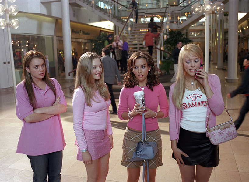 Image of the four lead characters from the film Mean Girls, wearing pink