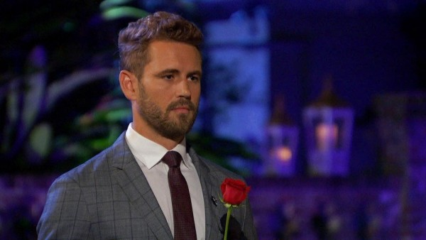 The Bachelor: Nick holds a rose ahead of the rose ceremony on episode 6.