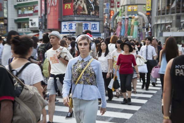Girls behind the scenes: Shoshanna walks down a busy street in Tokyo.