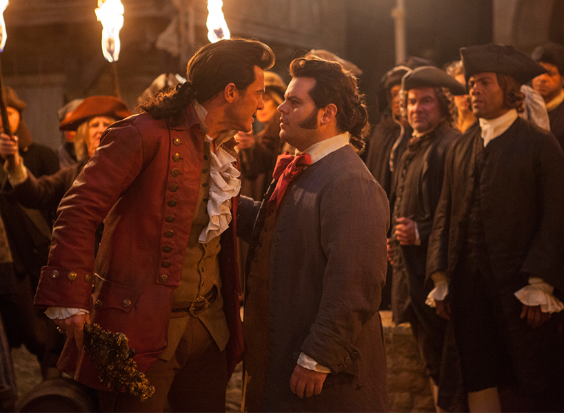 Gaston and LeFou face off in Disney's Beauty and the Beast