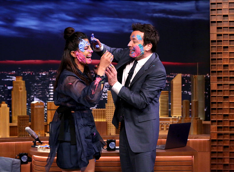 Priyanka Chopra and Jimmy Fallon cover each other in paint as a celebration of the Indian festival of Holi
