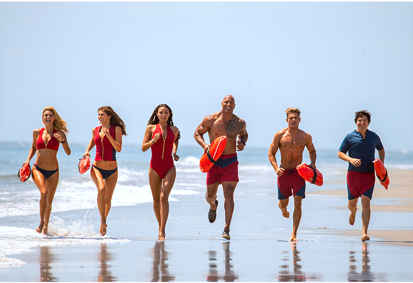 Baywatch Premier: Cast of Baywatch movie running along the Los Angeles shore.