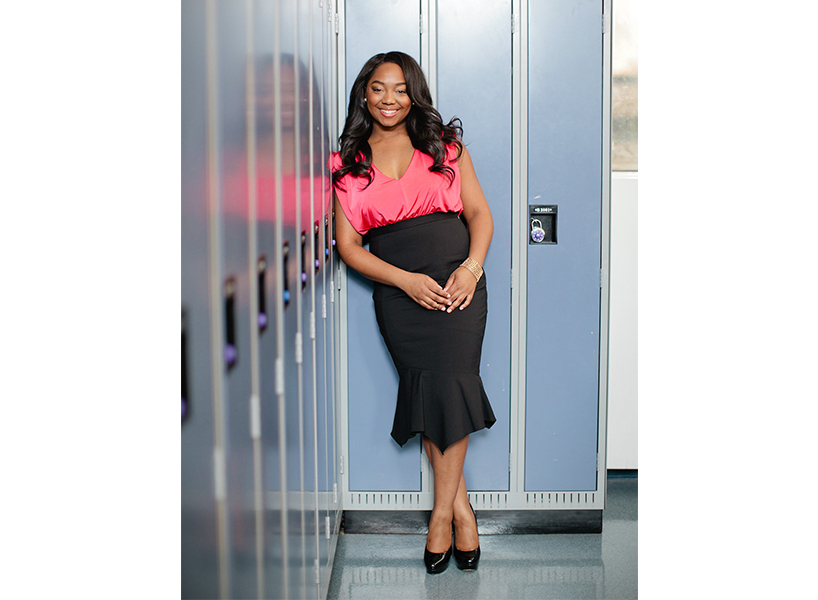 Ghostwriter: a headshot of Pauleanna Reid in a pink blouse.