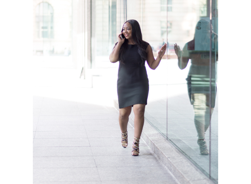 Ghostwriter: a headshot of Pauleanna Reid in a black shift dress.