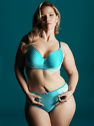 Elly Mayday, an up-and-coming Canadian plus size model, posing in turquoise lingerie as the face of Ovarian Cancer Canada's partnership with ADDITION ELLE; feature image.