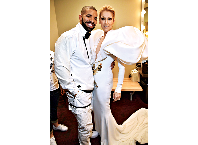 Rapper Drake and singer Celine Dion posing in white outfits