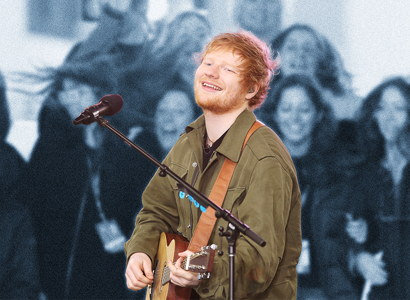 English singer Ed Sheeran in a green army jacket playing guitar for his fans