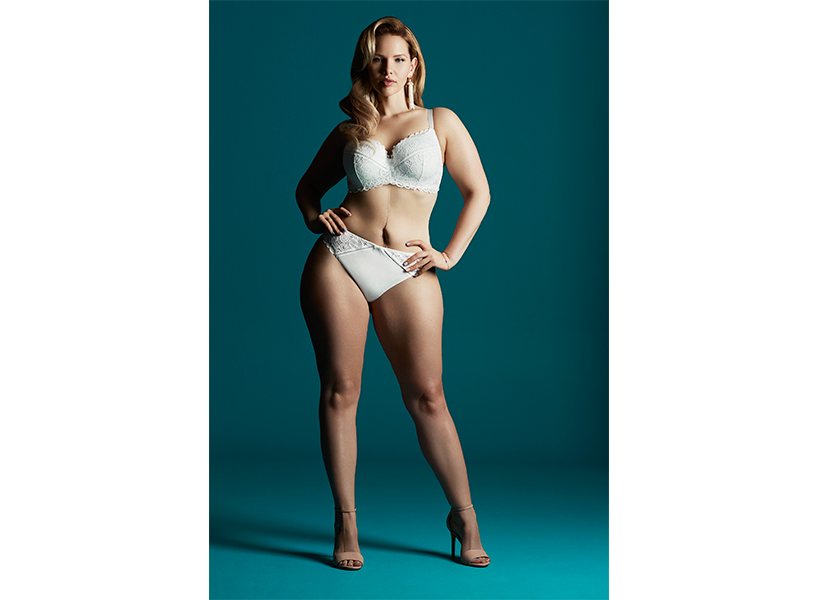 Elly Mayday, an up-and-coming Canadian plus size model, posing in white lingerie; inline image.