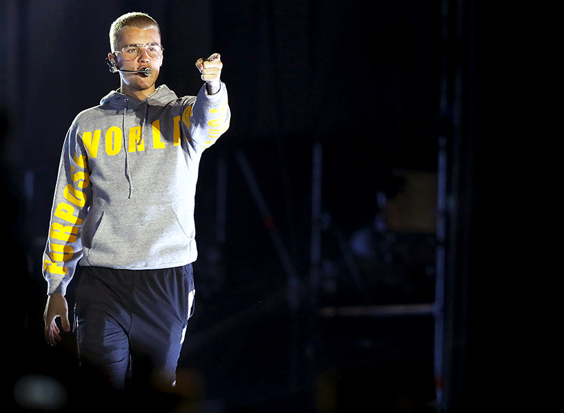 Canadian pop star Justin Bieber on stage pointing his finger