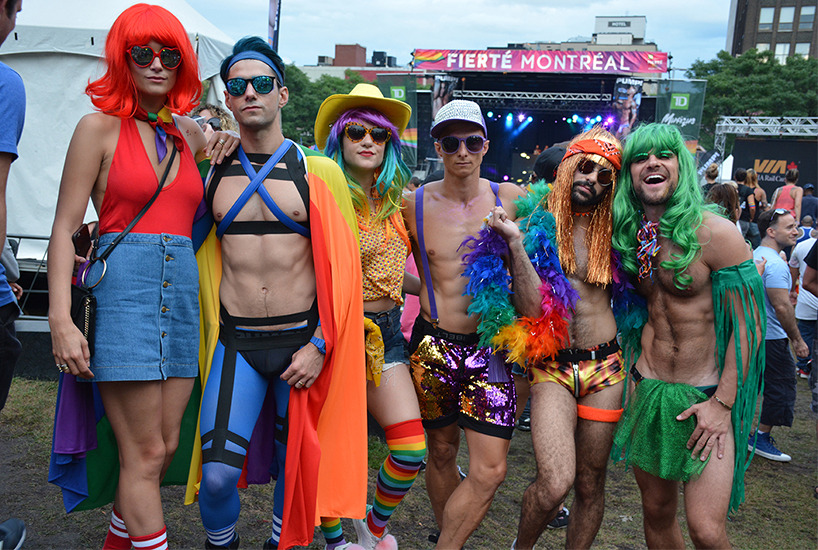 Here is a picture from the Mega T-Dance of a group in rainbow costumes during Montreal Pride