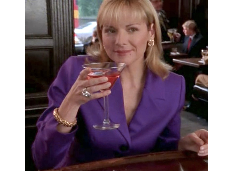 Samantha Jones' best Sex and the City outfits includes the purple power suit she's pictured wearing here.