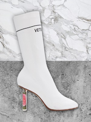 Celebs are loving white boots like this Vetements pair right now.