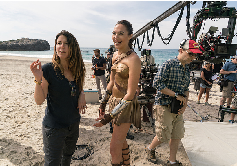 Director Patty Jenkins speaking with actress Gal Gadot on the set of Wonder Woman