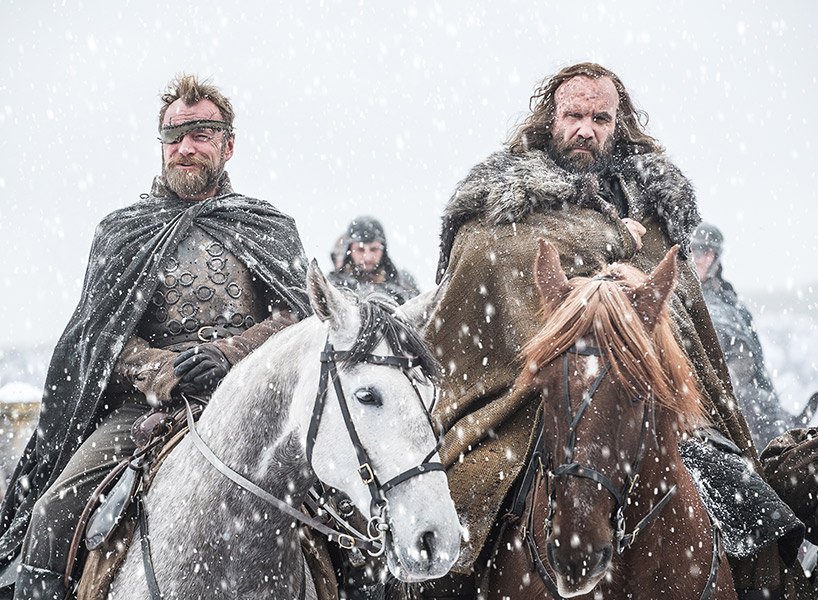 The Hound rides a horse through a snowfall on Game of Thrones