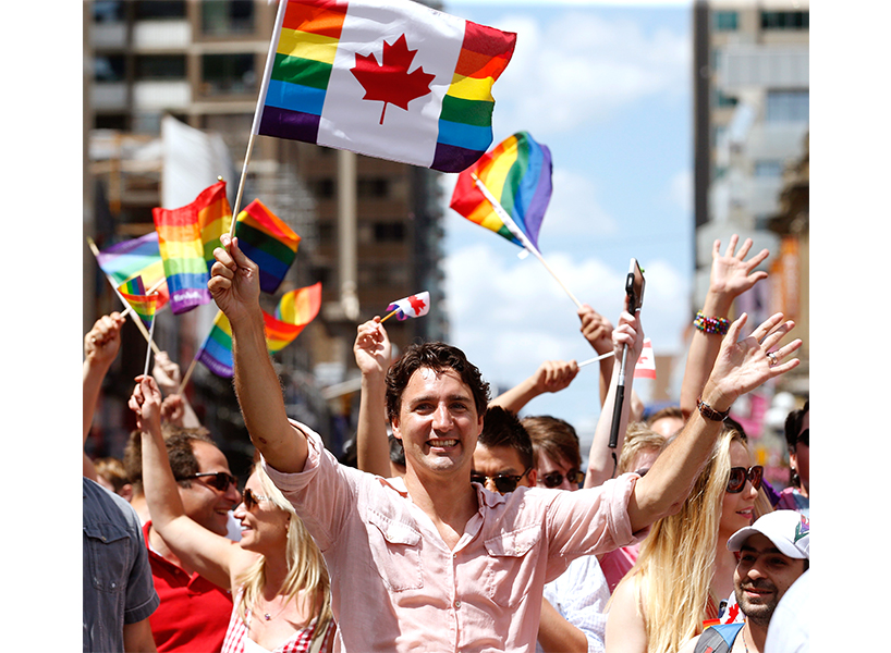 Prime Minister Justin Trudeau wearing a pink shirt at the 2016 Pride parade in Toronto.