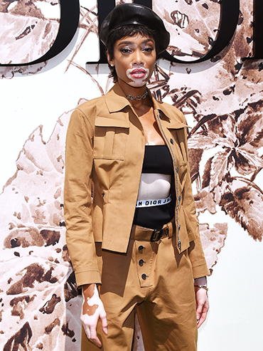 Winnie Harlow in a military chic look at Dior Haute Couture Fashion Week.