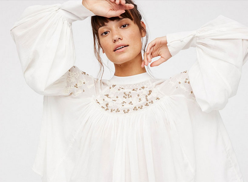 A pretty peasant top with managaeble volume is a smart and subtle way to reference a Seinfeld fashion moment like the puffy shirt