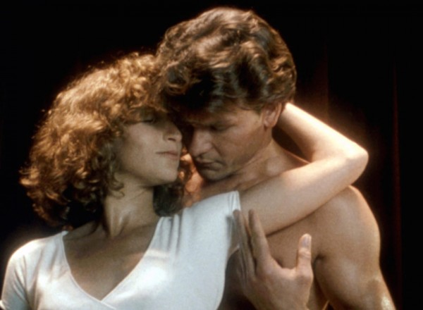 Baby and Johnny embrace in a still from Dirty Dancing.