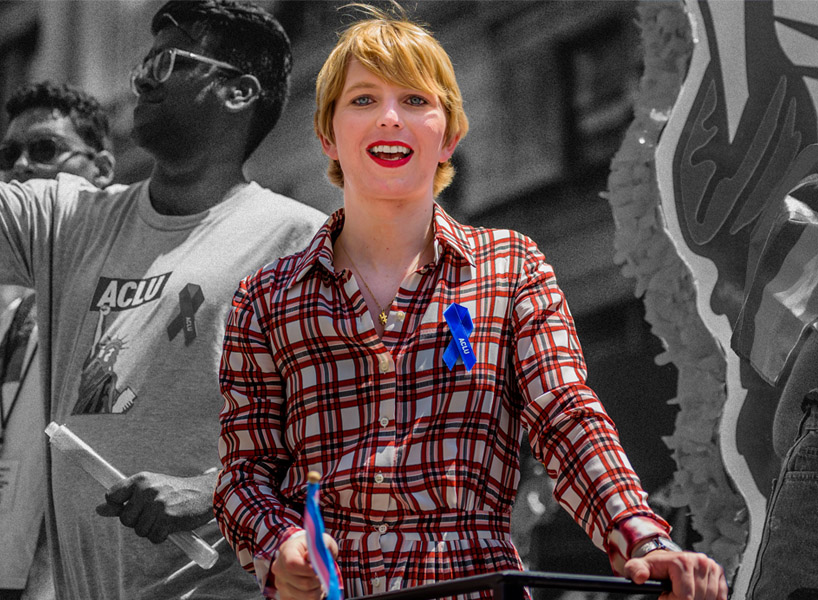 Activist Chelsea Manning in a plaid dress celebrating during Pride parade