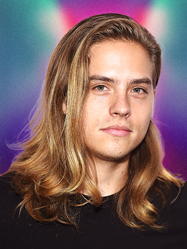 Dylan Sprouse posing with long hair
