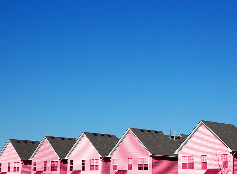 Returning home: a row of pink houses-inline