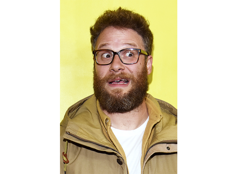 Actor and writer Seth Rogen posing with a confused look on his face wearing glasses