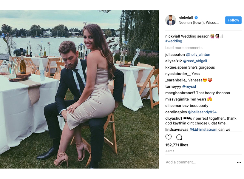 Vanessa sitting on Nick's lap at a wedding