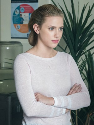 miss piggy bughead: Lili Reinhart as Betty Cooper with her arms crossed and looking annoyed in season two of Riverdale
