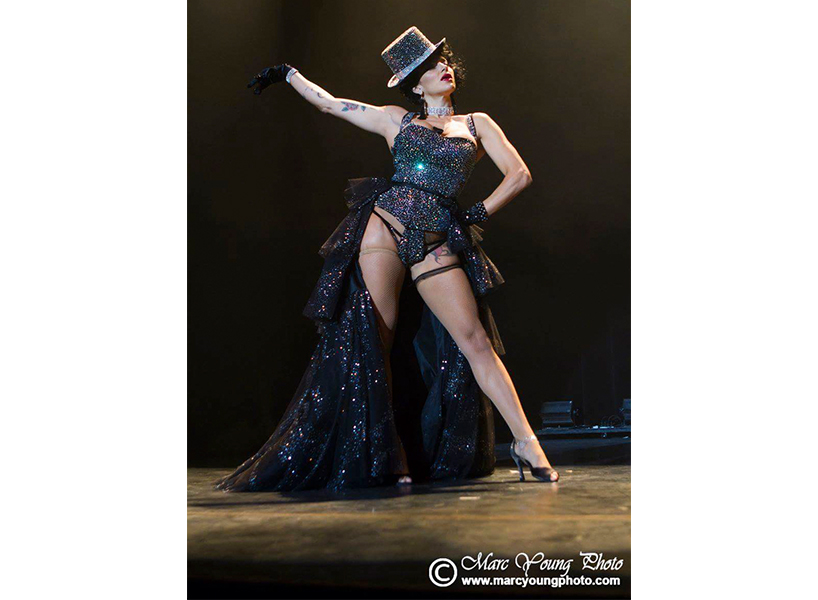 Pastel Supernova performs in a burlesque show in a black sparkling outfit.