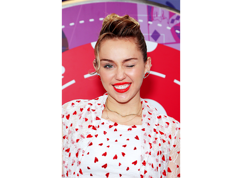miley cyrus winking wearing red lipstick