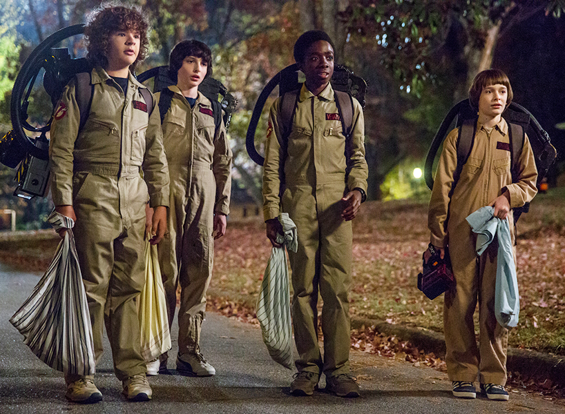 Cast of Stranger Things dressed as ghostbusters and out on Halloween, a screenshot from the upcoming season two