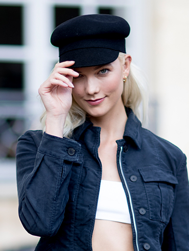 Paris Fashion Week Street Style: Karlie Kloss wearing a chic hat.