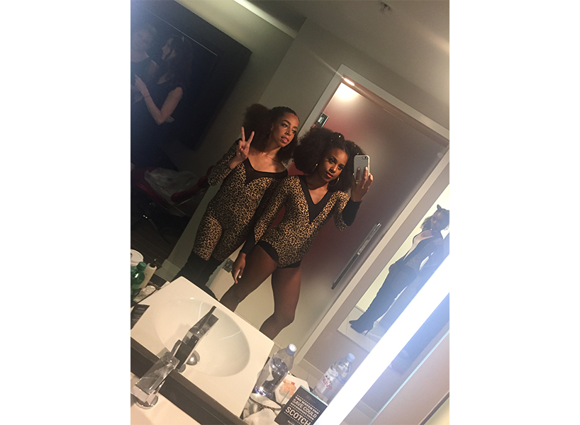 Asha Bromfield and Hayley Law posing on the set of Riverdale