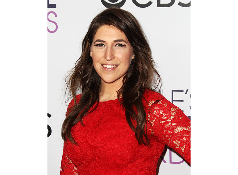 Mayim Bialik op-ed: Actress Mayim Bialik in a red lace dress with her brown hair curled and down by her shoulders on the red carpet