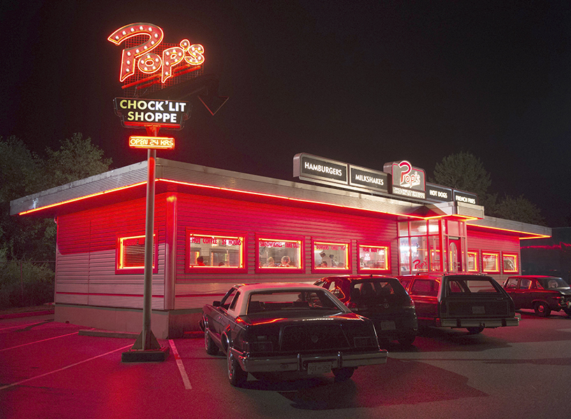 A photo of Pop's Chocklit Shoppe, glowing neon red from the show Riverdale