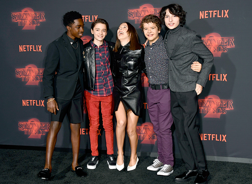 Caleb McLaughlin, Noah Schnapp, Millie Bobby Brown, Gaten Matarazzo, and Finn Wolfhard walk the black carpet at the Stranger Things 2 premiere in L.A. (Photo: Getty)