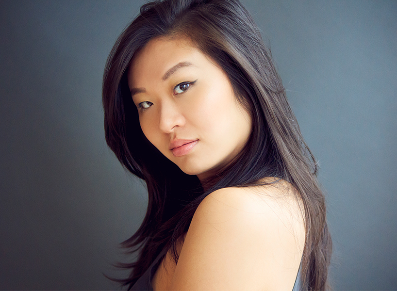 Actress Annie Chen with her hair down and looking at the camera, a headshot