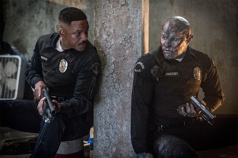 Will Smith and an alien in police uniforms in the film Bright