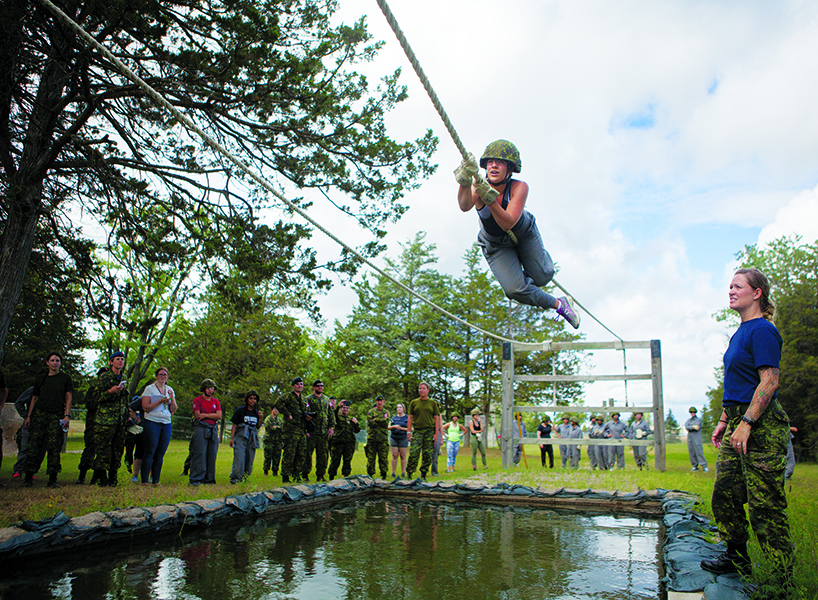 Canadian Armed Forces: Olivia Terenzio inches across a ropes obstacle