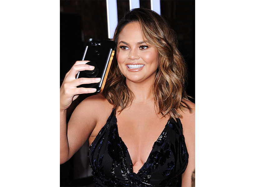 Chrissy Teigen VS Fashion Show: HOLLYWOOD, CA - NOVEMBER 02: Model Chrissy Teigen attends #REVOLVEawards at DREAM Hollywood on November 2, 2017 in Hollywood, California. (Photo by Barry King/Getty Images)