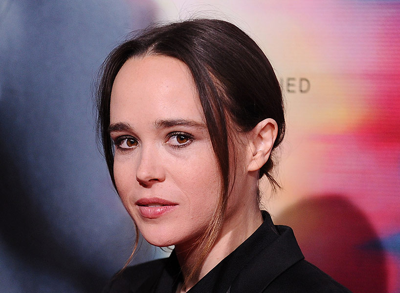 Ellen Page wears a black suit with a white pocket square