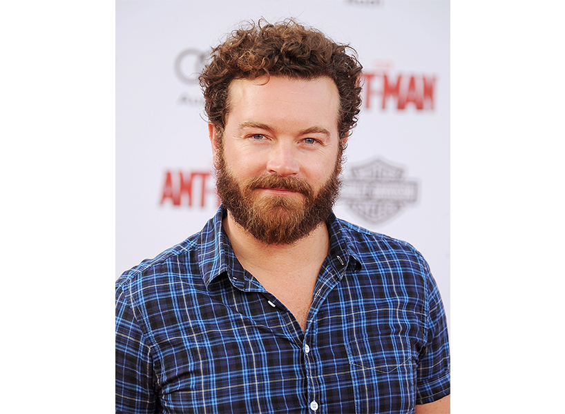 Actor Danny Masterson posing in a blue plaid shirt