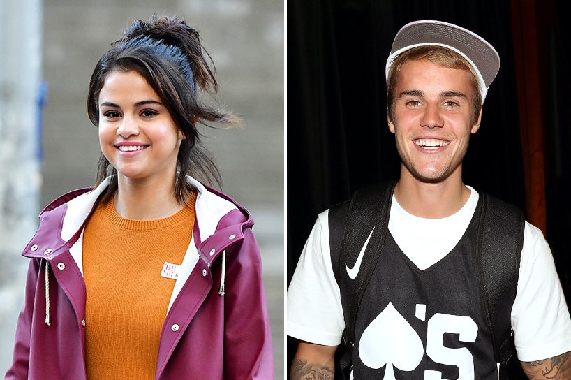 Justin Bieber and Selena Gomez together: Photo of Justin wearing a black jersey over a white tee and Selena in a mustard top and maroon jacket.